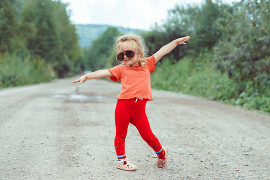 little girl dancing in glasses