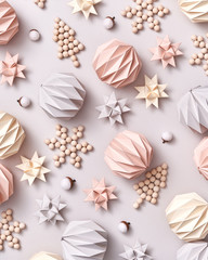 Handcraft wooden decorative Christmas trees, paper origami balls and stars on a gray background. Christmas layout. Flat lay