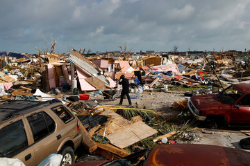A man walks among debris at the Mudd neighborhood, devastated after Hurricane Dorian hit the Abaco Islands in Marsh Harbour