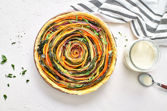 Stock Photo of a Vegan Organic Vegetable Spiral Tart and Cashew
