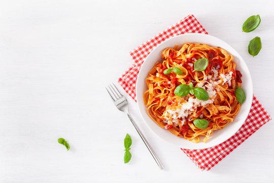 tagliatelle pasta with tomato sauce parmesan basil