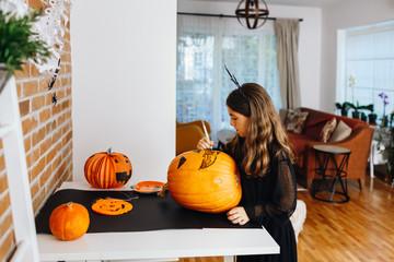 Girl prepare decorations for Halloween