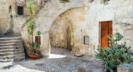 Wall Murals Old building Street of the historic center of Matera Italy - European capital of culture 2019