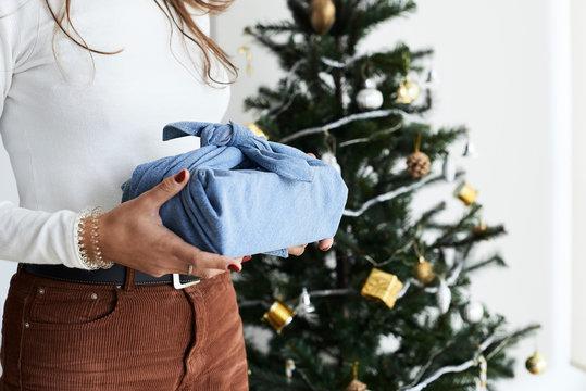 Holding furoshiki wrapping gift.