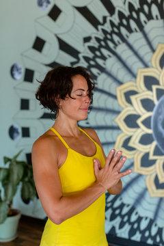 A Professional Yoga Teacher Leads A Group Class