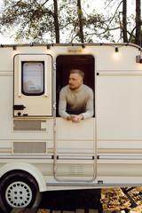 Man relaxing in caravan