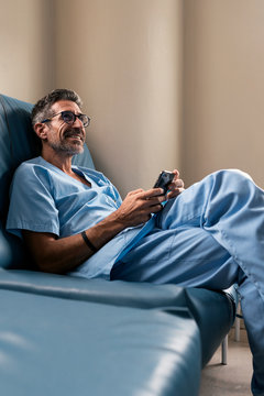 Doctor using mobile after work
