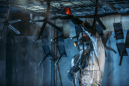Worker painter at industrial factory
