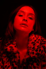Amazing woman portrait in red light