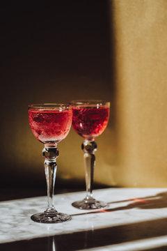 Pink champagne on vintage glasses