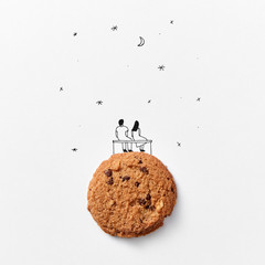 Cookies with a drawn man and woman on a background of the starry