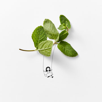 A natural branch of green mint and a drawing with a liner handle