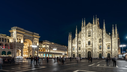 Fototapete - Milan Cathedral or Duomo di Milano at night, Italy. This place is a top landmark of the Milan. Panorama of the famous Milan city center at dusk. Long exposure of main Milan square with blurred people.