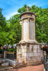 Fototapete - Monument of Lysicrates, Athens, Greece. It is an ancient landmark of the city. Classical Greek ruins in the Athens center near Acropolis. Vertical view of remains of old historical Athens in summer.