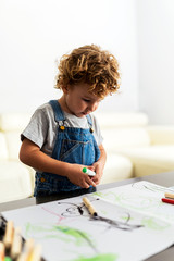 Portrait of cute baby drawing