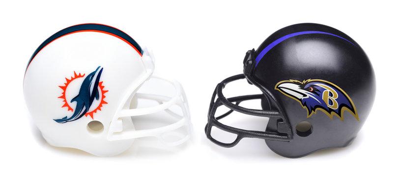IRVINE, CALIFORNIA - SEPTEMBER 6, 2019: Football helmets of the Miami Dolphins vs Baltimore Ravens, Week One opponents in the NFL 2019 Season
