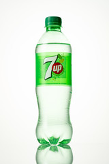 MINSK, BELARUS, APRIL, 5, 2018: Bottle of 7 Up Soft Drink Soda isolated on white. 7 Up is a brand of lemon-lime flavored non-caffeinated soft drink first introduced in 1929.