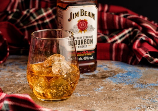 MINSK, BELARUS - OCTOBER 31, 2018: Bottle and glass Jim Beam is one of best selling brands of bourbon in the world, produced by Beam Inc. in Clermont, Kentucky.