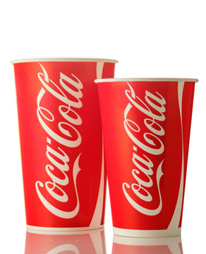 MINSK, BELARUS-APRIL 19, 2018: Paper cups of Coca-Cola. Coca-Cola is a carbonated soft drink sold in stores, restaurants, and vending machines throughout the world.