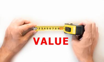 hands holding measure tape measuring value