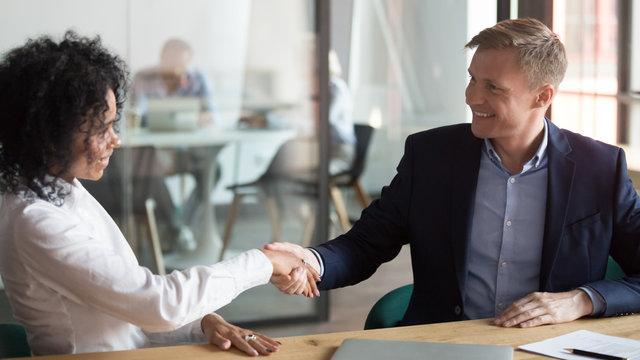 Multiethnic business partners handshake greeting at meeting