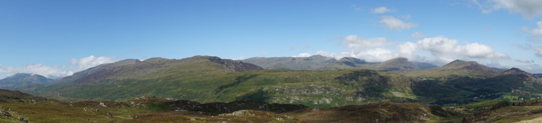 Printed kitchen splashbacks Khaki High Mountain Range with Brilliant Blue Sky and Clouds - Wales UK