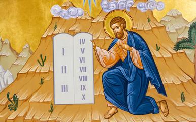 Secovska Polianka, Slovakia. 2019/8/22. The icon of Moses receiving the Ten Commandments on the Mount Sinai. The Greek Catholic church of Saint Elijah.
