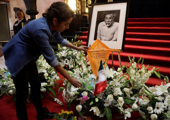 A man places a kite to pay a tribute to late Mexican graphic artist Francisco Toledo at Bellas Artes Palace near downtown Mexico City