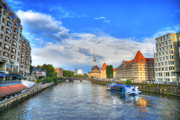 Colorful beautiful HDR image of Berlin cityscape - Museum Island and the famous TV Tower on blue cloudy sky