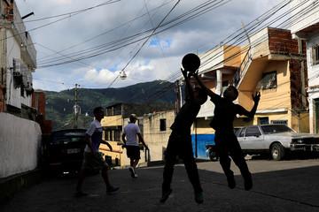 Children play basketball in Caracas