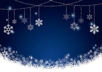 雪の結晶のオーナメントと青い背景