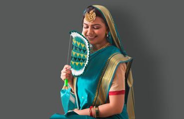 Beautiful woman holding a fan in hand