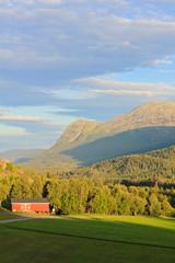 Norwegian, red farmhouse in the countryside in beautiful Hemsedal, Buskerud, Norway.