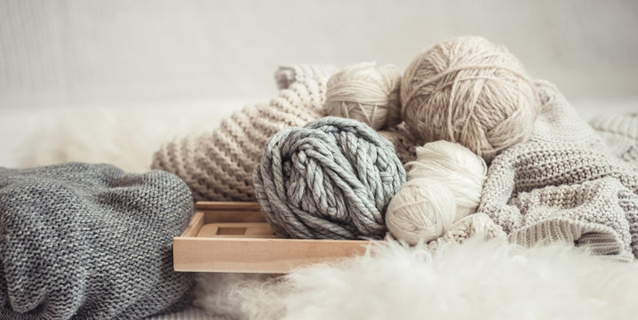 cozy background Wallpaper with the yarn for knitting.