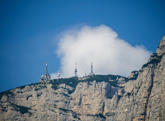 Radio telecommunications masts, towers on mountain top in th Dolomites, South Tyrol, Italy.
