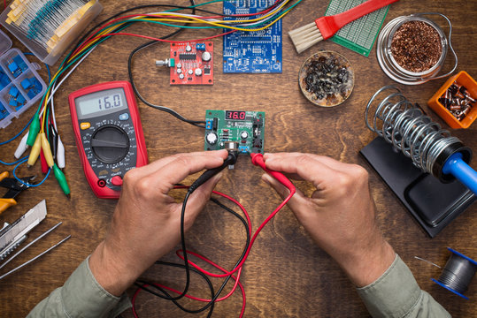 Working with electronics.