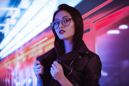 Asian Woman in the City at Night.