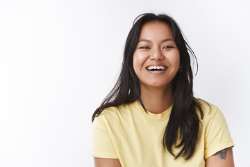 Lifestyle, body positive and people concept. Portrait of happy attractive carefree young malaysian girl with tattoo and facial flaws smiling, laughing from joy and happiness expressing positivity