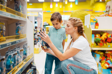 Happy mother with her little son in kids store
