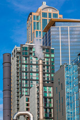 Fototapete - Smokestack and Modern Buildings in Seattle Washington