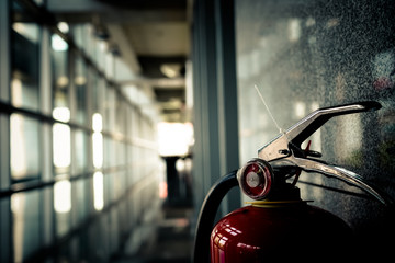 Scooter Close up of Fire extinguisher. Interior of Building in public place.