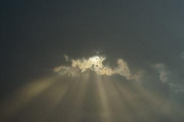 Rays of light in grey sky