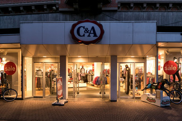 SNEEK, THE NETHERLANDS - NOVEMBER 2, 2018: C&A branch. C&A is an international chain of fashion retail clothing stores, with European head offices in Vilvoorde, Belgium, and Dusseldorf, Germany.