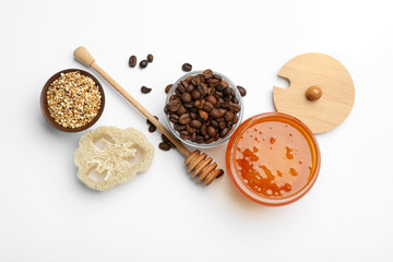 Different ingredients for handmade face mask on white background, top view