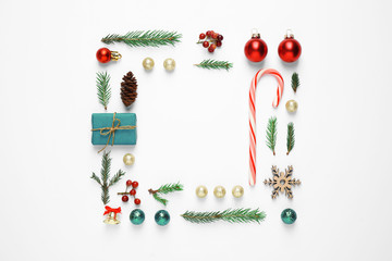 Fotobehang - Flat lay composition with Christmas gift and festive decor on white background. Space for text