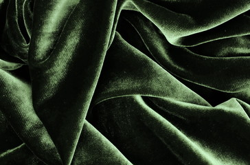 velvet texture grey green colors background, expensive luxury fabric, material,  wallpaper. copy...