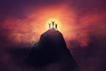 Together overcoming obstacles as a group of three people raising hands up on the top of a mountain. Celebrate victory and success over sunset background. Goal achievement symbol. Wall mural