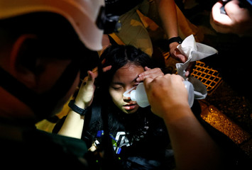 A woman gets first aid near Mong Kok police station in Hong Kong