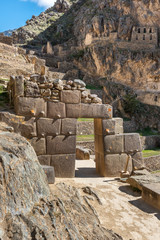 Ollantaytambo ruins with arch through a stone wall