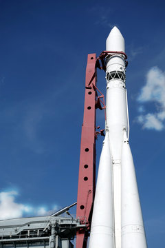 Spaceship on launch pad ready to fly into space vertical photo over blue sky